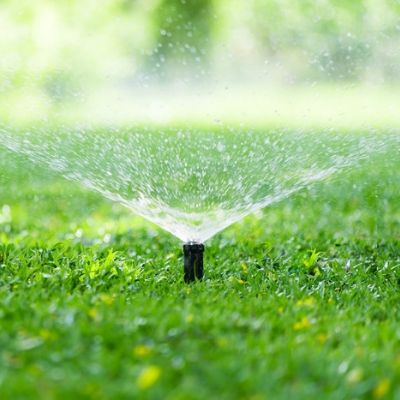 Summer lawn care here in Londonderry, NH includes proper sprinkler system maintenance.